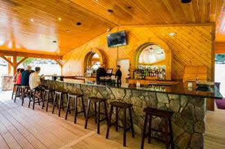 Pavilion bar with wood siding and stone table