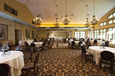Terraview dining hall with multiple chandeliers and tables set in black cloths