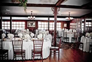 Woodsgate dining hall with white table settings
