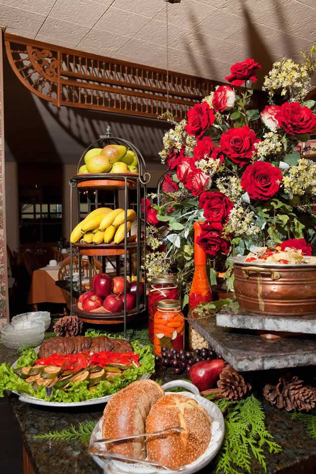 A display of food includes fruit baskets and breads