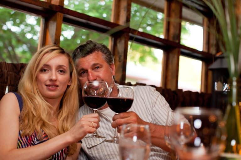 Couple enjoying wine - making toast