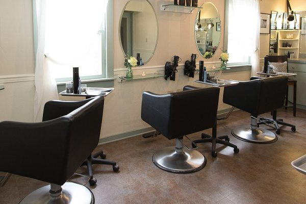 Inside of the spa beauty area with multiple hair salon stations and mirrors